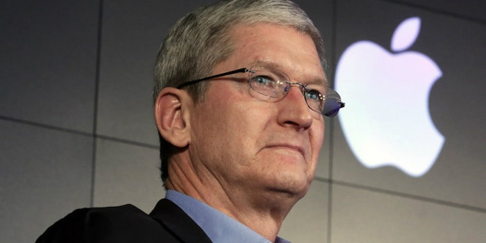 Tim Cook in front of an Apple Logo